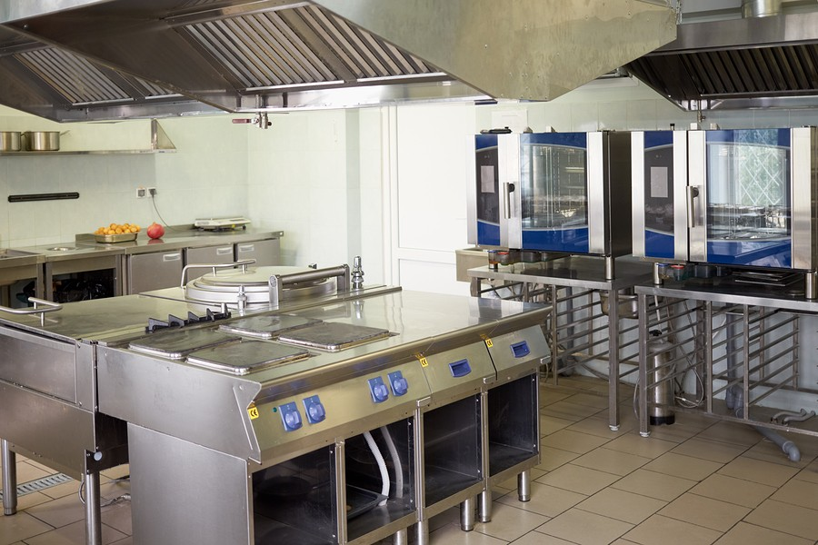 kitchen room with stoves, sinks and refrigerators in restaurant.